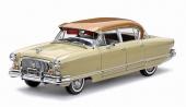 Modellbil 5112 är lackerad i Anniversary Gold Metallic över Champagne Ivory. Versionen har inte Continental kit.